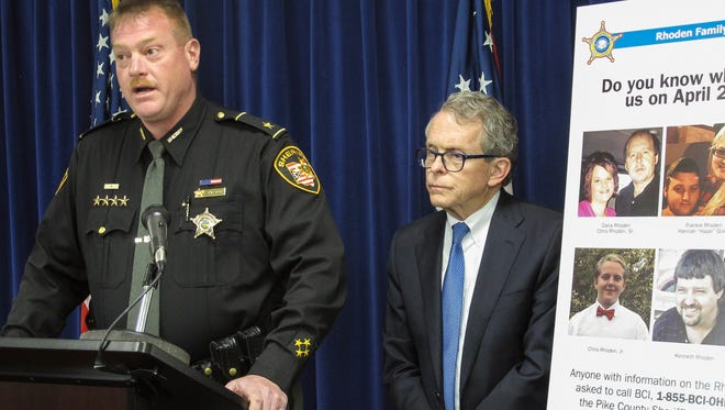 Pike County Sheriff Charles Reader, left, discusses the ongoing investigation into the unsolved killings of eight family members at a news conference Thursday, April 13, 2017, attended by Attorney General Mike DeWine, whose office is leading the investigation.