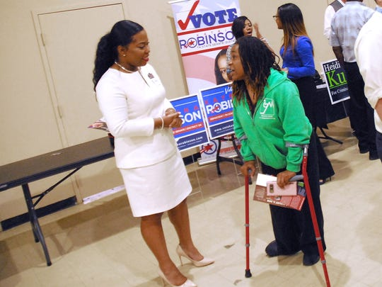 Katrina Robinson, left, meets with voters during an election event at Abundant Grace Fellowship in Memphis on July 9.