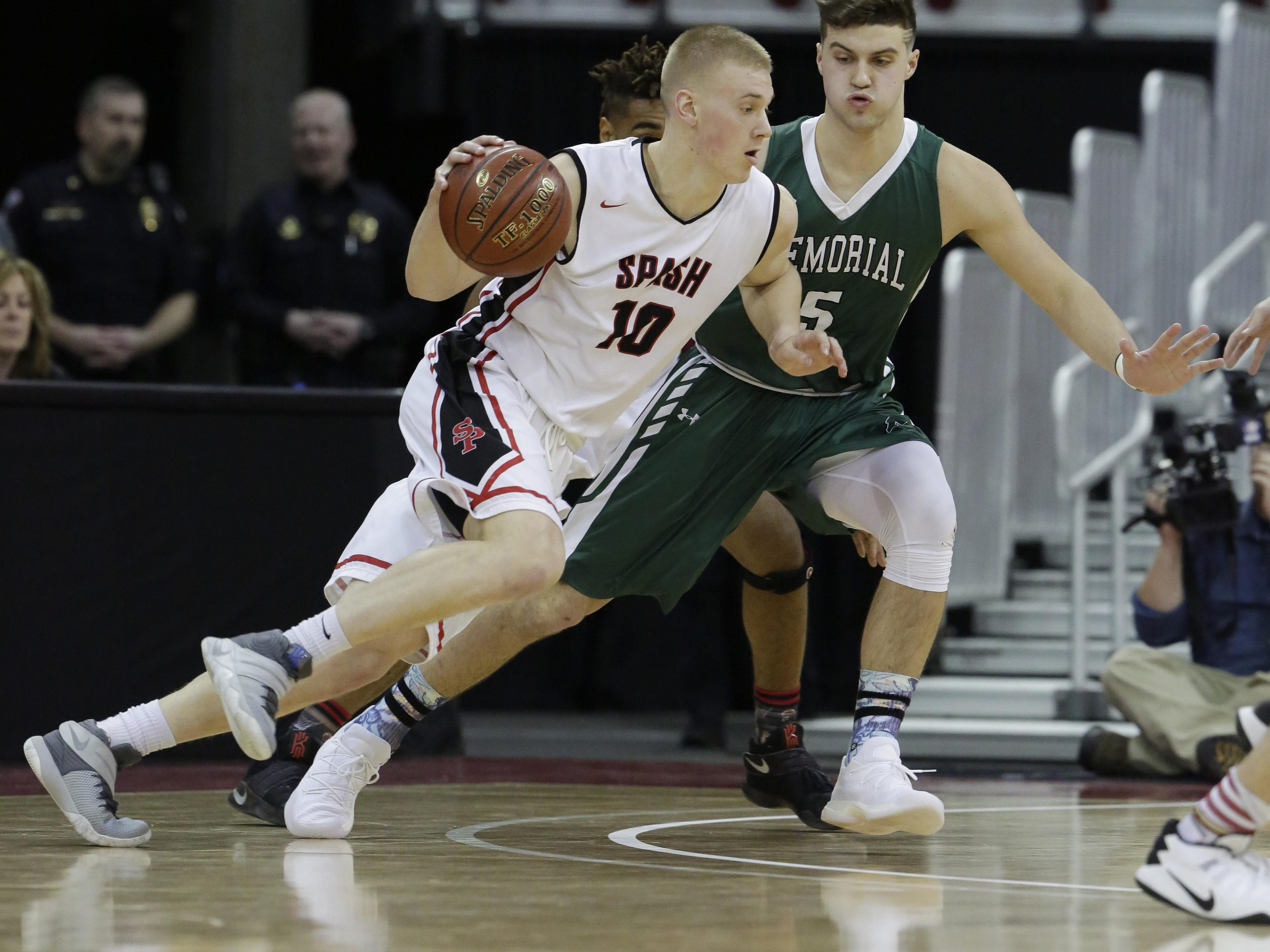Stevens Point's Joey Hauser dribbles to the inside against Madison Memorial in a WIAA Division 1 state semifinal on Friday at the Kohl Center.