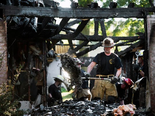 Firefighters sift though the remains of a home in the 1700 block of Verdan Dr. S in Spring Garden Twp.