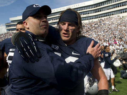 Penn State head coach Bill O'Brien, left, embraces Michael Mauti following his team's 39-28 victory over Northwestern on Oct. 6, 2012. Mauti, now with the Minnesota Vikings, is featured prominently in a new book about the 2011 Big Ten football season.