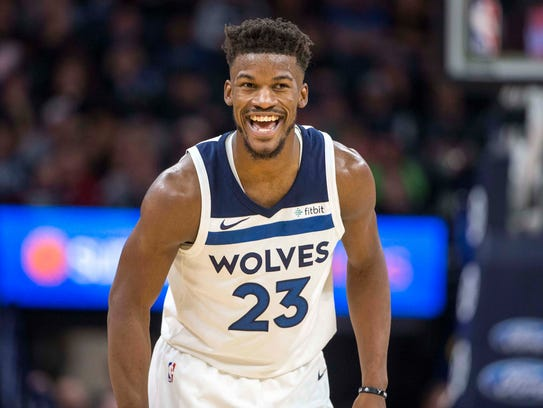 Minnesota Timberwolves guard Jimmy Butler (23) smiles