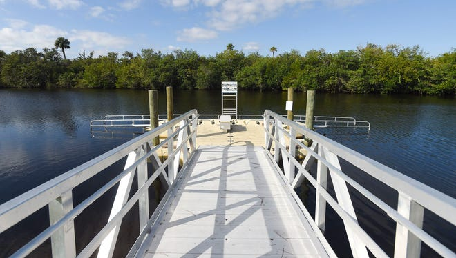 A handicapped-accessible kayak launch, seen on Friday, Dec. 23, 2016, along with an access road located in the Halpatiokee section of the Savannas Preserve State Park, cost the city of Port St. Lucie $1 million. The access road and kayak launch diminished 5 acres of untouched land and environmentalists say the addition of the Crosstown Parkway Extension will destroy another 30 acres of the park.