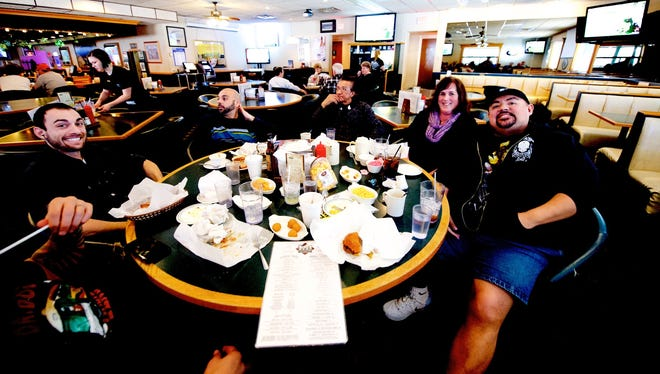 Comedian Gabriel Iglesias, right, has lunch Sunday at Kroll's West in Ashwaubenon with members of his crew and the Press-Gazette Media entertainment writer invited to crash their party.
