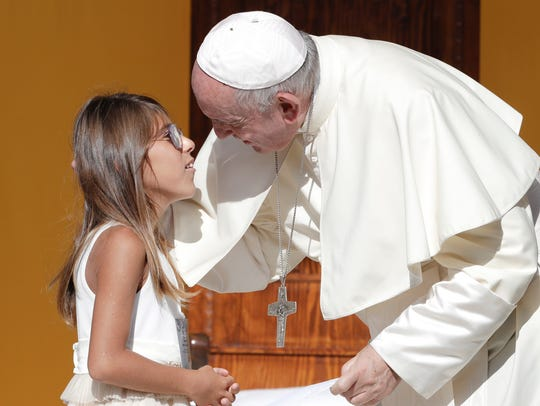 Pope Francis greets a young girl during his visit to Piazza Armerina, Italy, on Sept. 15, 2018. Pope Francis was paying tribute in Sicily to a priest who worked to keep youths away from the Mafia.