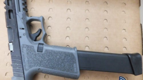"A ""ghost gun"" that Boston police say was carried illegally by a Canton man and woman."