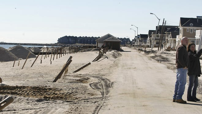 People observe damage along the beachfront n November 2012 as Manasquan homeowners were allowed back to their homes.