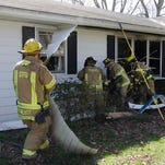 Firefighters from Springfield and Madison townships fight a house fire at 133 Scotland Blvd. Thursday morning.