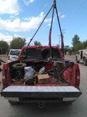 A small disassembled aircraft allegedly used to fly drugs over the border was in the bed of a truck.