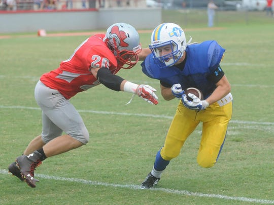 Mountain Home's Marshall Roberson, right, runs after
