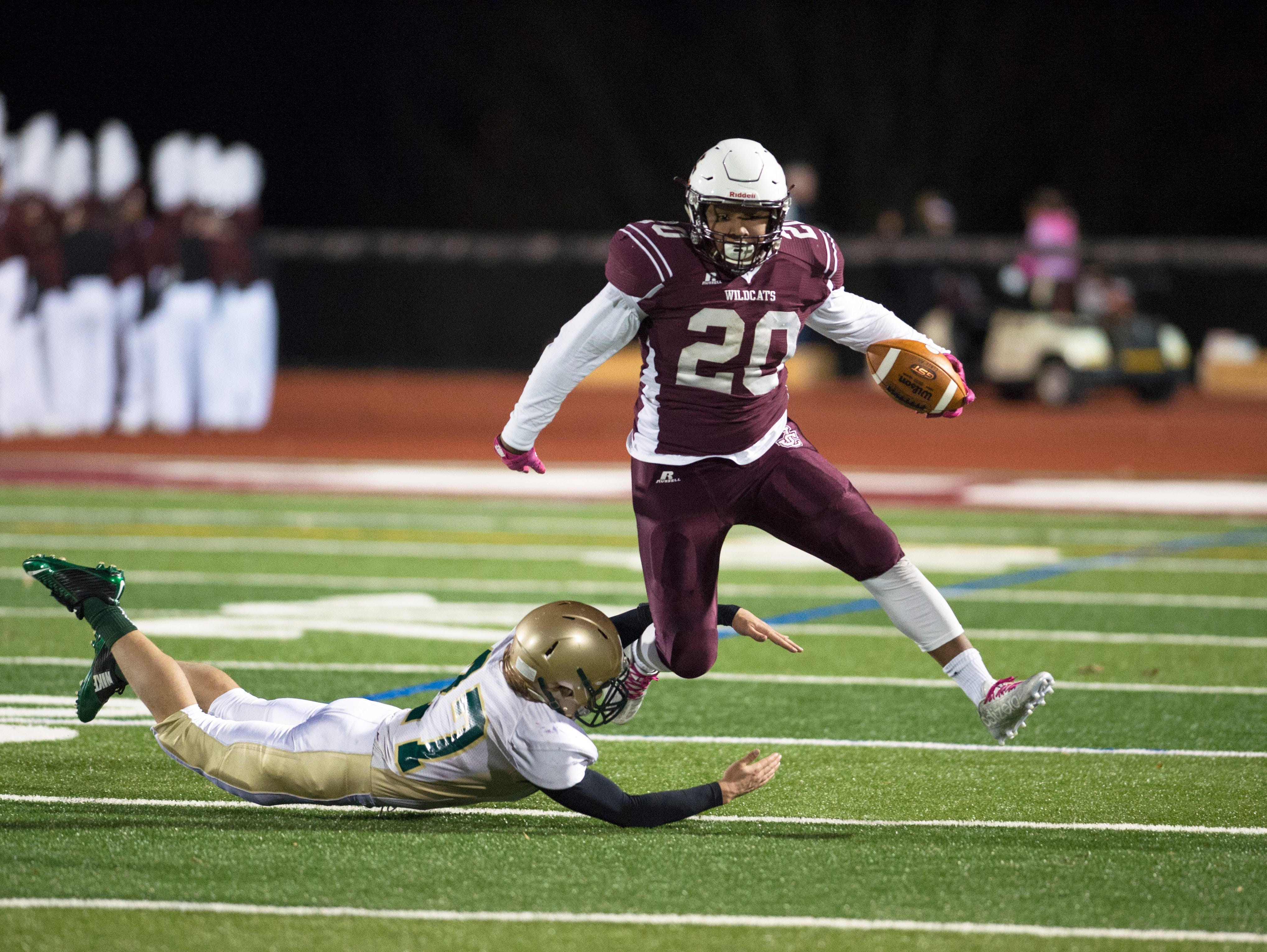 Johnson City running back Dominic Nadz eludes a Vestal defender during the second quarter of JC's 29-6 win over Vestal in the Section 4 Class A semifinal playoff game on Friday.