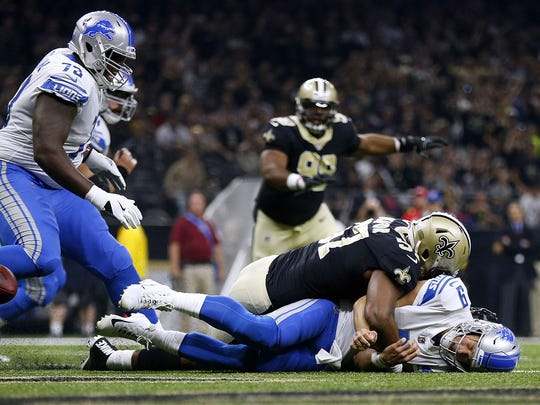 Saints' Alex Okafor gets past Greg Robinson (73) to force a fumble on Matthew Stafford at the Mercedes-Benz Superdome last season.