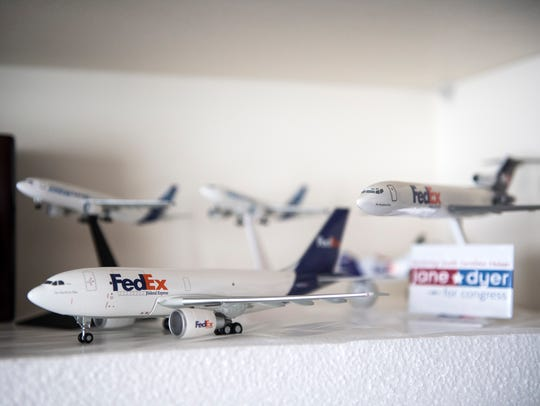 Models of FedEx airplanes are on display in Jane Dyer's