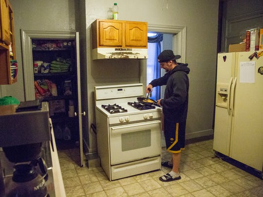 David Hartnett, a resident at Harbor of Hope cooks lunch on Wednesday, Jan. 3, 2017, in Des Moines. The recovery house that offers individual help to men coming from prison, jail or treatment to recover from addiction.