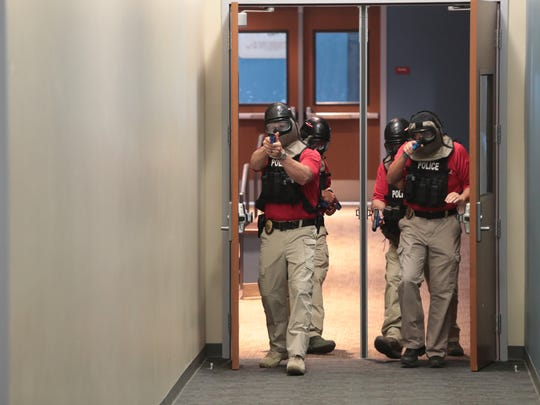 Officers from the Indio Police Department conduct active shooter training at Indio High School, July 9, 2018.