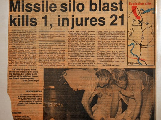 """Copy of newspaper clipping shows Devlin being carried out of the blast zone. Greg Devlin of Titusville was in the U.S. Air Force stationed in Arkansas in 1980 when a Titan II missile exploded, killing one man and injuring several, including Devlin. The incident is the subject of a book """"Command and Control"""" , documentary airing on PBS."""