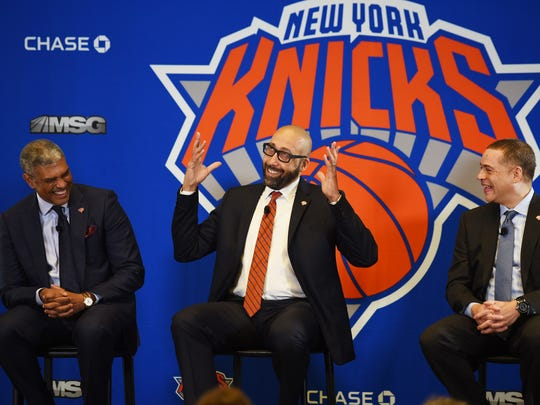 Knicks new head coach David Fizdale (C) shares a laught