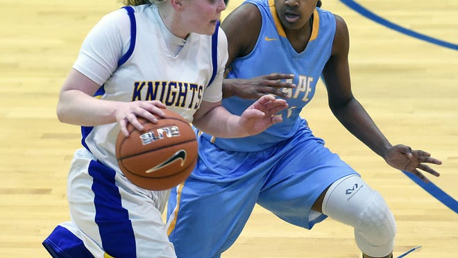 Centrala Emily Truitt drives the ball down court as Capes Lexi Watkins defends as Sussex Central and Cape Henlopen varsity girls played in the 1st Round of the Girls DIAA Basketball Tournament at Sussex Central HS in Georgetown on Tuesday March 1st.