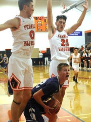 Yerington's Kevin Kirk looks for options as he is guarded by Fernley's Drew Miller and Russell Ortiz.