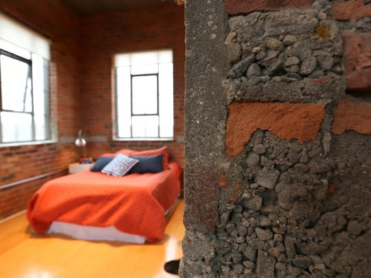 Second Level with exposed brick and access to the private deck.