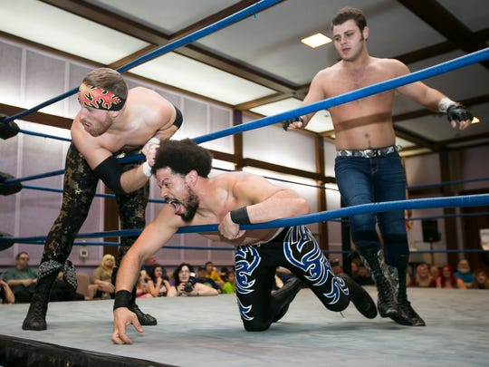 Tag team champions Greg Romero and Ricky Gibson have Marcus Malone against the ropes in a double team matchup at West Coast Wrestling Connection's 11th Anniversary Show at the Scottish Rite Center on Sunday, March 6, 2016.