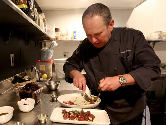 Chef Vitaly Paley prepares a poke made with fresh and