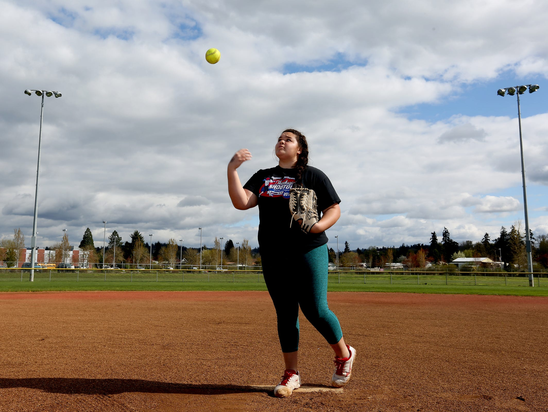Junior softball player Alex Molloy stands for a photo at Silverton High School on Monday, March 28, 2016.