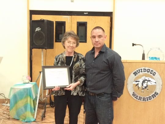 Vivian Skinner and Pat Garrett (pictured) were both presented an award by Director Anthony Montes  for 5,000 volunteer hours served.