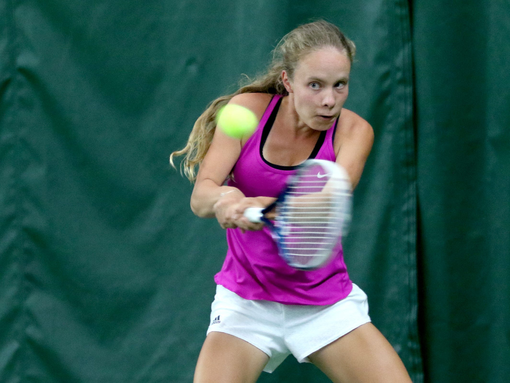 West Salem's Anya Gerasimov competes in the girl's singles third place match at the Greater Valley Conference district meet at the Salem Tennis and Swim Club on Saturday, May 14, 2016.