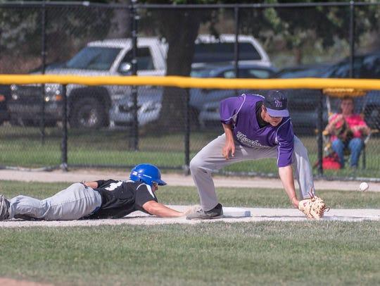BC Merchants's first baseman Jason Mueller attempt