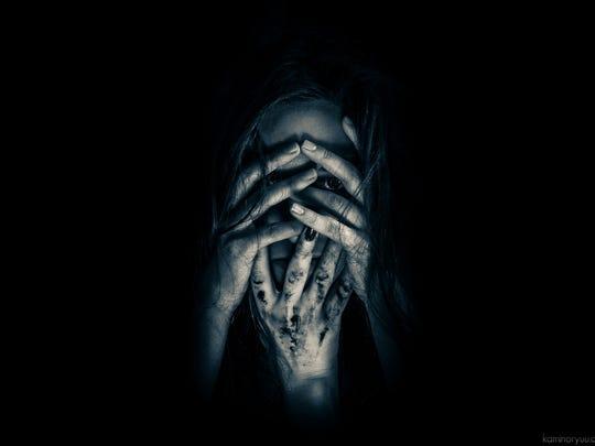 A promotional image for Bonita Blackout Asylum Haunted House