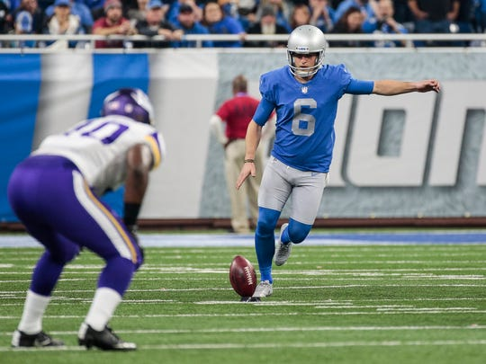 Lions' Sam Martin kicks off in the second half against
