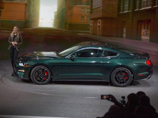 With a little help from Steve McQueen's granddaughter Molly McQueen, Ford reveals the 2019 Mustang Bullitt during the North American International Auto Show at Detroit's Cobo Center Sunday, Jan. 14, 2018.