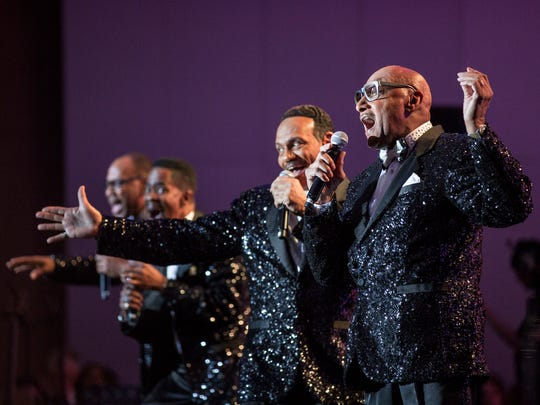 The Four Tops perform during the closing ceremony of