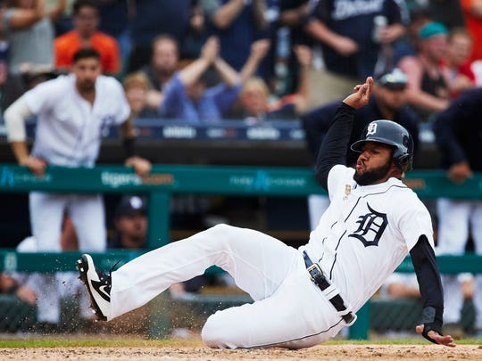 Jun 2, 2018; Detroit, MI, USA; Detroit Tigers' Ronny Rodriguez slides safely at home in the eighth inning against the Toronto Blue Jays at Comerica Park.