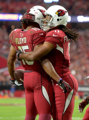 Michael Floyd (15) celebrates the second of his two TD catches with Larry Fitzgerald.