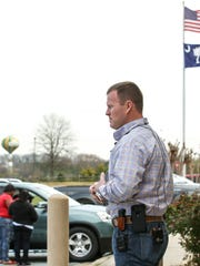Anderson County Sheriff Chad McBride watches as relatives of missing man Emmanuel Quarles leave the sheriff's office Wednesday after meeting with him. Quarles has been missing since April 20, 2015.