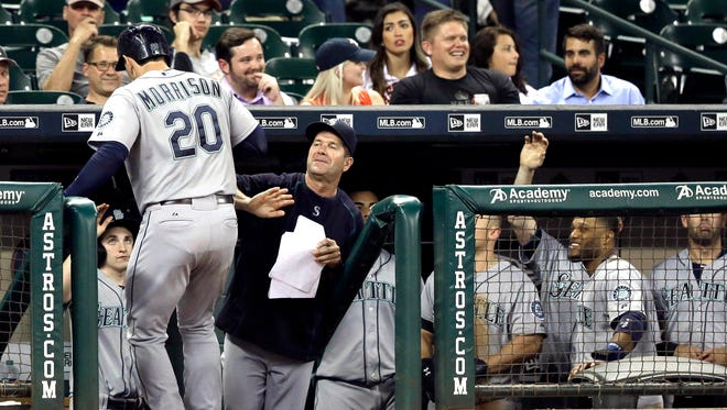 Seattle Mariners' Logan Morrison (20) is welcomed back to the dugout after hitting a two-run home run against the Houston Astros during the eighth inning of a baseball game Tuesday, Sept. 1, 2015, in Houston.