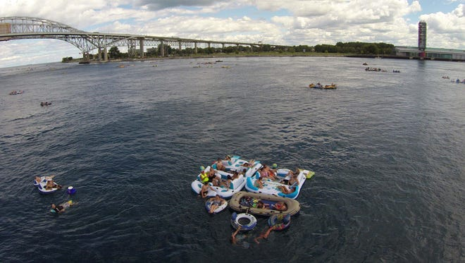 Floaters travel down the St. Clair River during Float Down Sunday, Aug. 21.