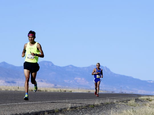 Half marathon runners Leandrew Martine and Rodell Williams compete, Saturday, May 5, 2018, in Shiprock. Martine won the half marathon and Williams took second.