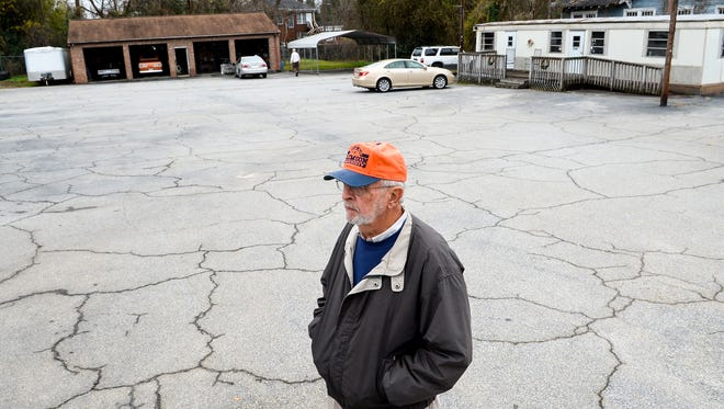 Bill Wells of Hi-Way Motors on South Main Street in Anderson stands in a near-empty car lot on Thursday. Wells and his brother Jerry Wells are closing at the end of the year, ending a run of the business at the same location since 1951.