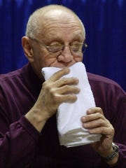 Jerry Tarkanian bites on his trademark towel in this file photo.