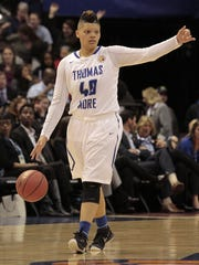 Sydney Moss of Thomas More directs her teammates.