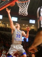 MTSU's Reggie Upshaw Jr. (30) goes up for a shot during