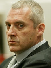 Tom Sizemore listens to the reading of the verdict