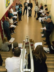 In the hallway at Benjamin Franklin Middle School, cast members read their parts.