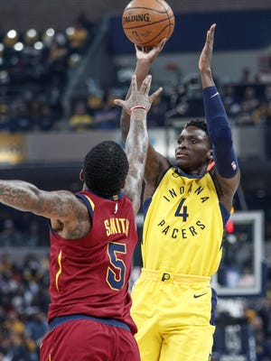 Indiana Pacers guard Victor Oladipo (4) shoots over Cleveland Cavaliers guard JR Smith (5) during the first half of Game 4 at Bankers Life Fieldhouse on Sunday, April 22, 2018.