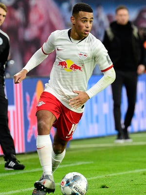 FILE - In this Saturday, Dec. 21, 2019 file photo Leipzig's Tyler Adams controls the ball during the German Bundesliga soccer match between RB Leipzig and FC Augsburg in Leipzig, Germany. (AP Photo/Jens Meyer, file)