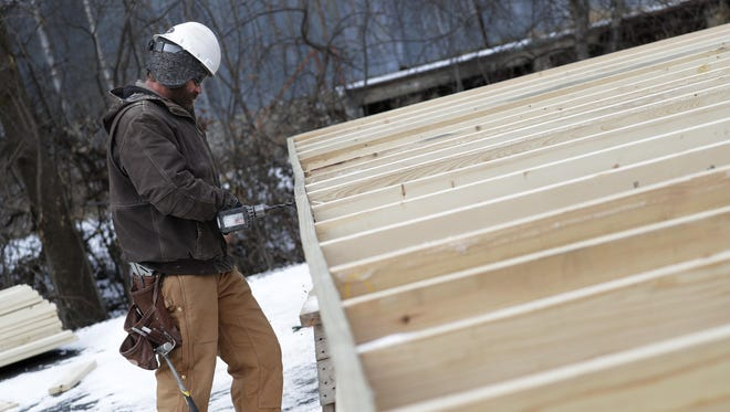 Russ Wartenberg braves bitter temperatures to build a wall for one of eight large storage units along Valley Road on Dec. 12 in Menasha. Wartenberg is an employee with Forrest Construction Inc., out of Luxemberg.