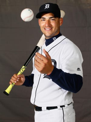 """Tigers' short stop Jose Iglesias gets his picture taken on """"Photo Day"""" during Detroit Tigers spring training at Joker Marchant Stadium in Lakeland, Fla. on Saturday, Feb. 27, 2016."""